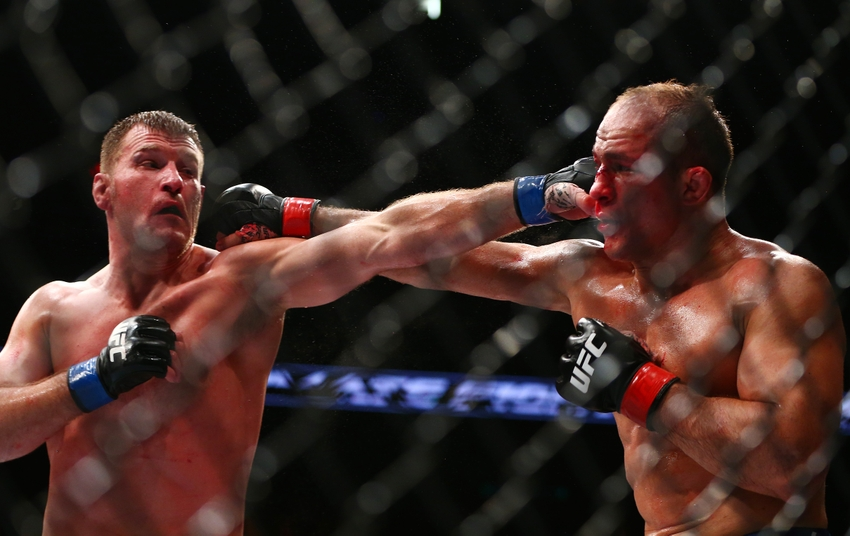 December 13, 2014; Phoenix, AZ, USA; Stipe Miocic and Junior Dos Santos hit one another during UFC Fight Night at US Airways Center. Mandatory Credit: Mark J. Rebilas-USA TODAY Sports