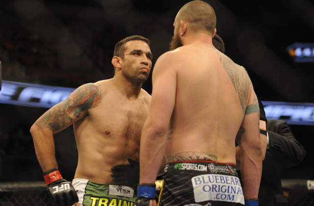 Apr 19, 2014; Orlando, FL, USA; Fabricio Werdum (red gloves) stares down opponent Travis Browne (blue gloves) before their heavyweight fight during UFC on FOX 11 at Amway Center. Mandatory Credit: David Manning-USA TODAY Sports