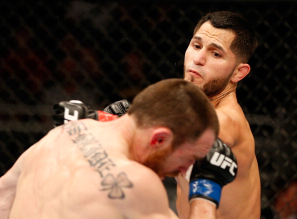 ORLANDO, FL - APRIL 19: (R-L) Jorge Masvidal punches Pat Healy in their lightweight bout during the FOX UFC Saturday event at the Amway Center on April 19, 2014 in Orlando, Florida. (Photo by Josh Hedges/Zuffa LLC/Zuffa LLC via Getty Images)